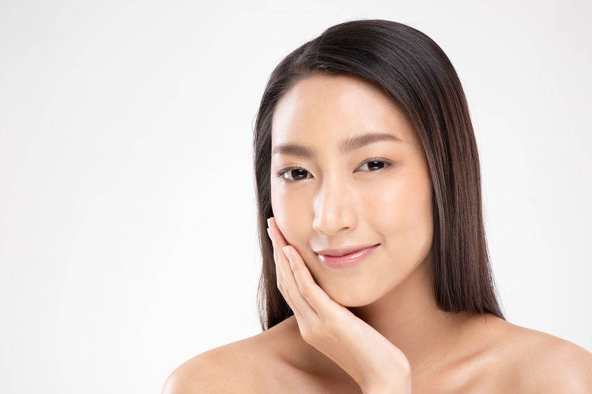 young woman touching soft cheek smile with clean and fresh skin Happiness and cheerful with positive emotional,Beauty and Cosmetics Concept.